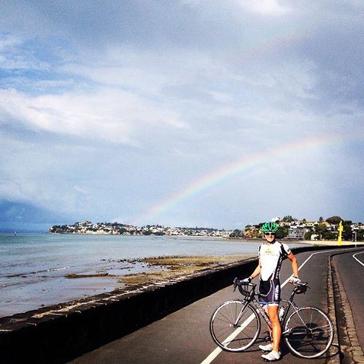 Katie rainbow on bike NZ